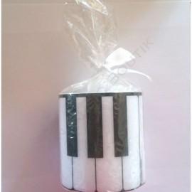 Bougie ronde blanche clavier de piano